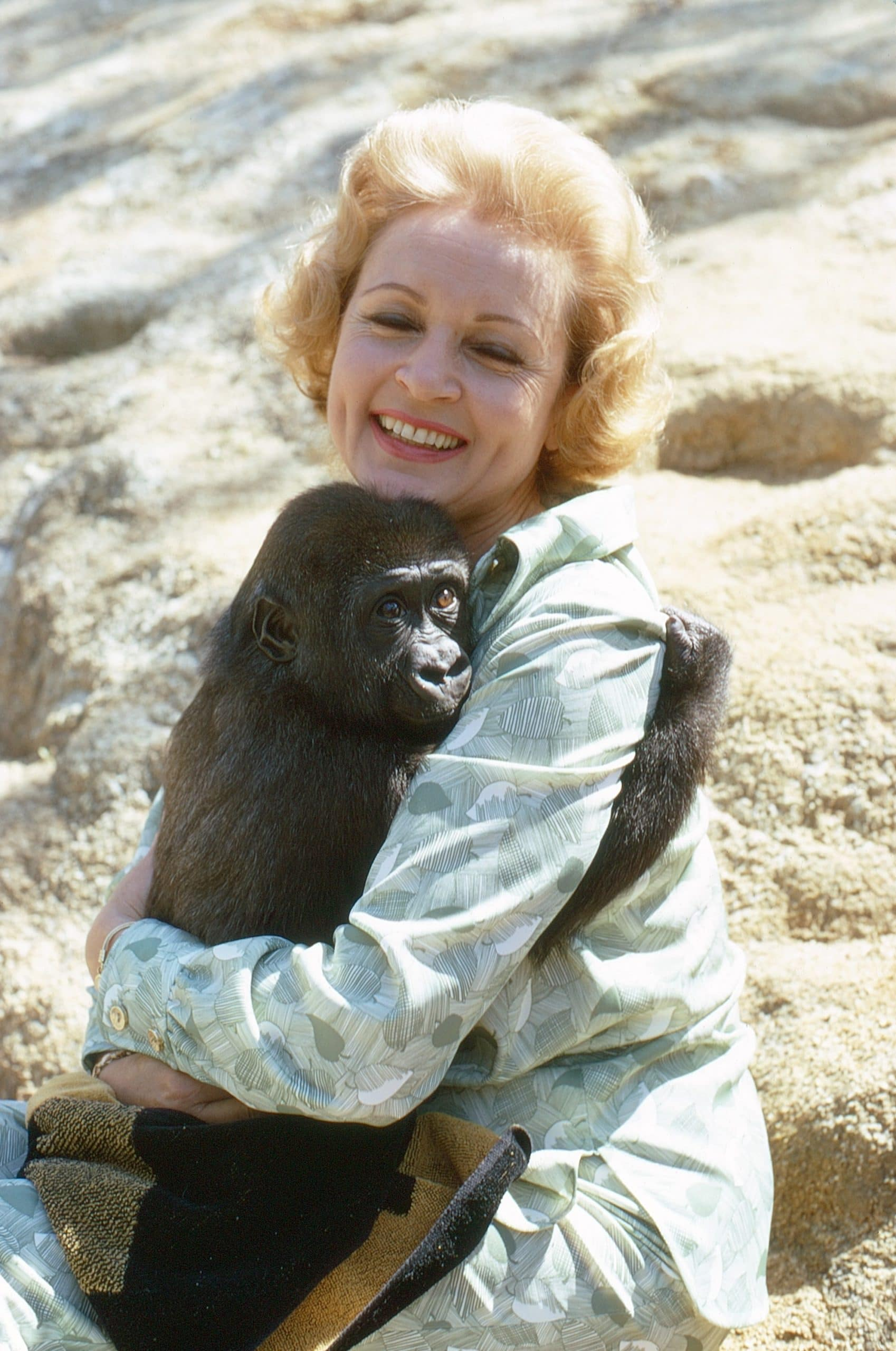 Betty White, embracing a chimpanzee