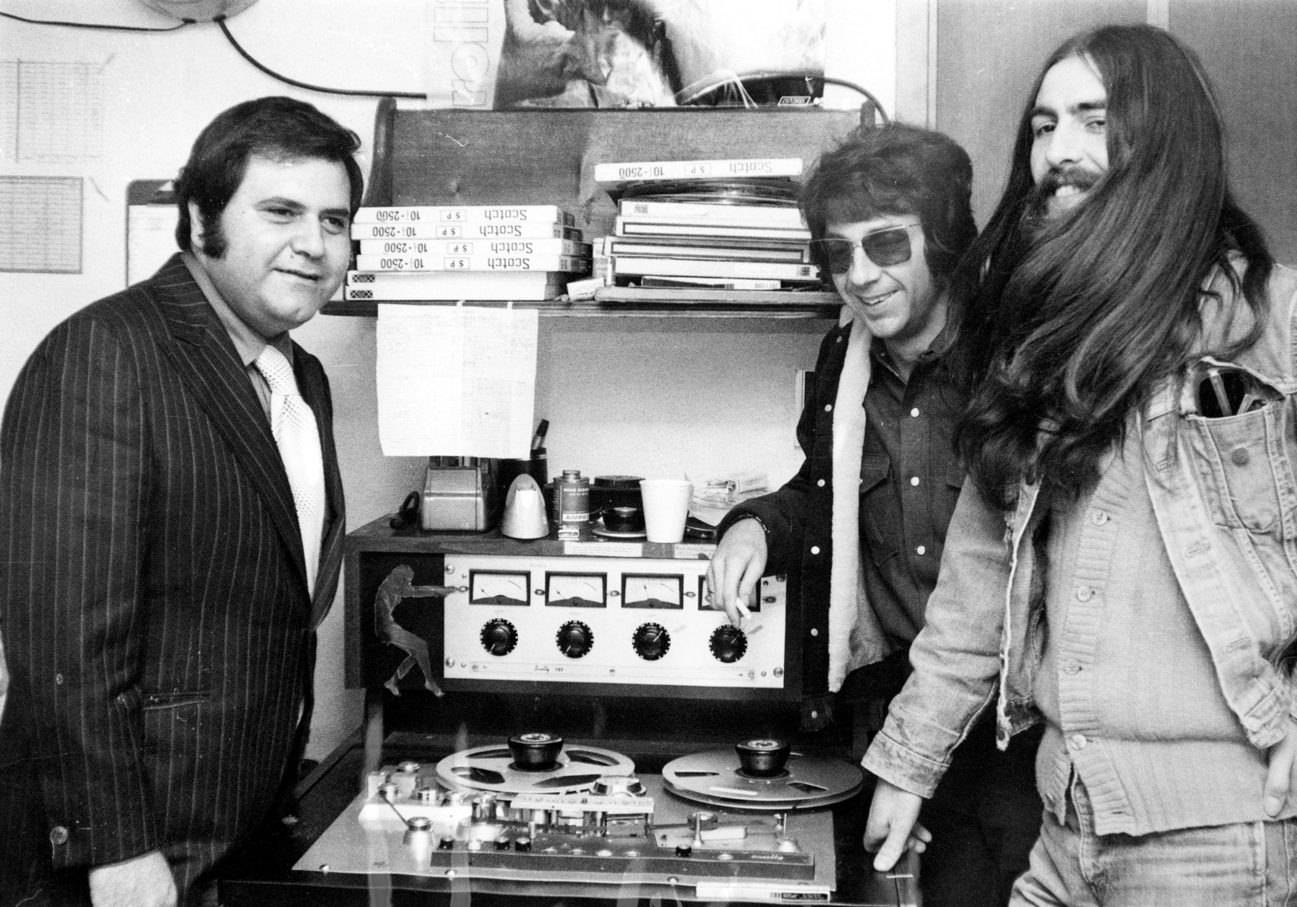 George Harrison (far right) with Apple Records executive Pete Bennett and producer Phil Spector