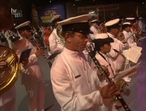 Military orchestra instrumentalists gathered from all corners of the globe to work together as one