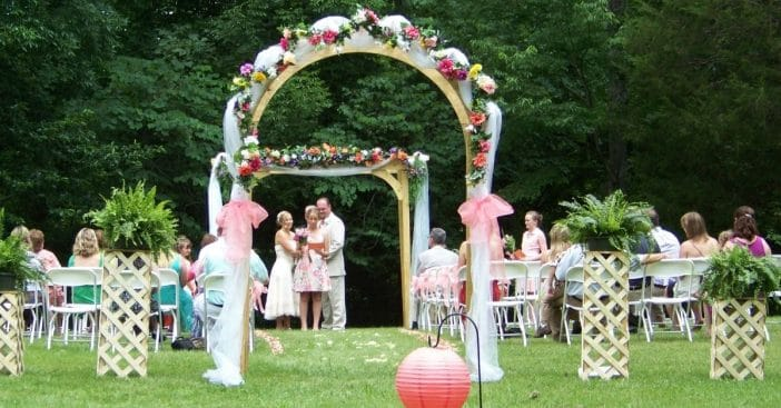 The wedding arch in question was handmade by the groom