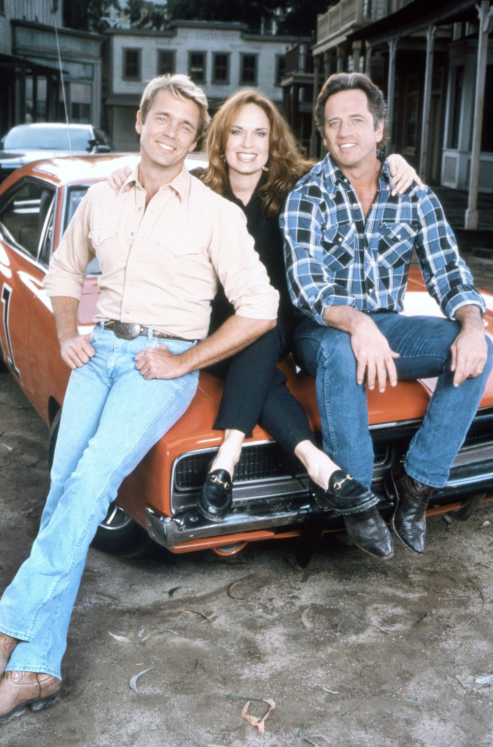 THE DUKES OF HAZZARD: REUNION!, (from left): John Schneider, Catherine Bach, Tom Wopat