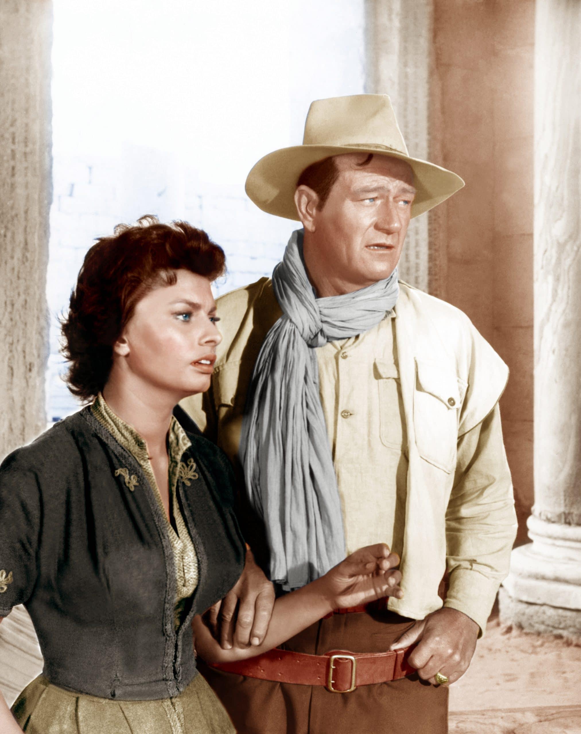 LEGEND OF THE LOST, from left: Sophia Loren, John Wayne, 1957