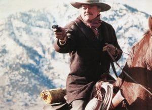 While still moving up his own career ladder, Sam Elliott met John Wayne during Wayne's last film