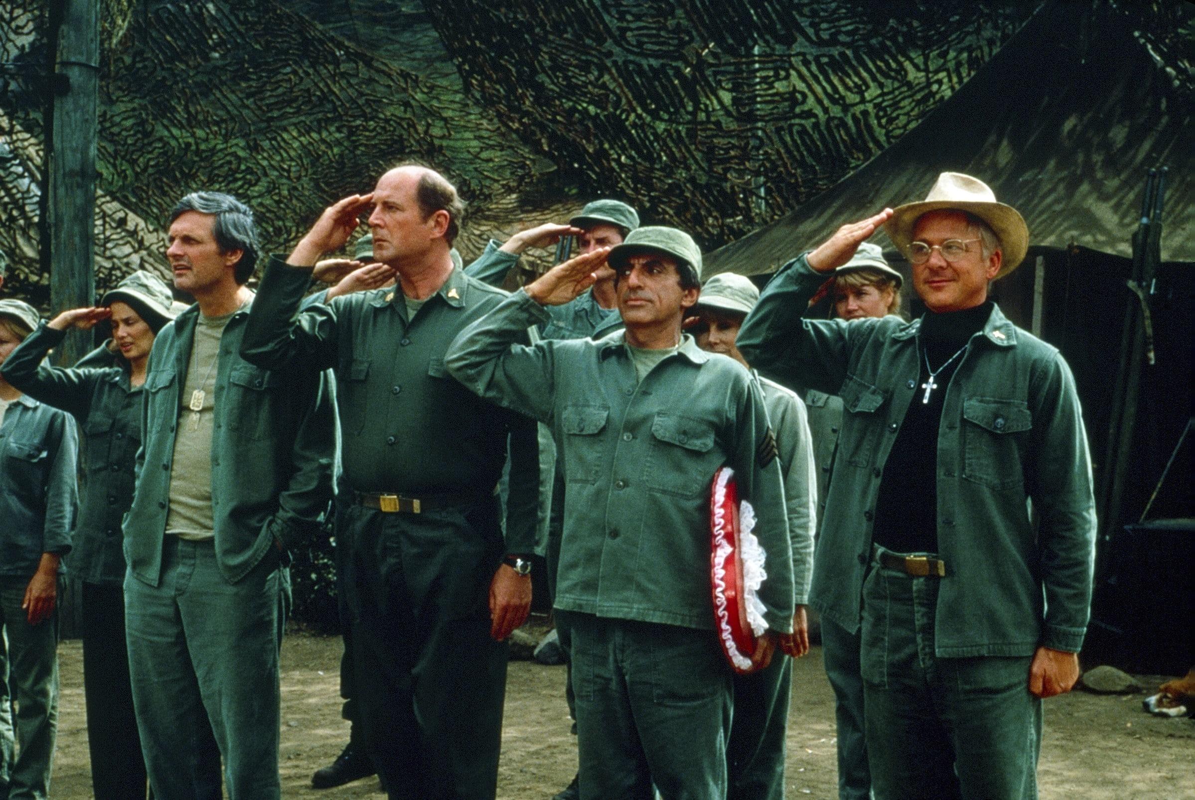 MASH, (aka M*A*S*H*), front, from left: Alan Alda, David Ogden Stiers, Jamie Farr, William Christopher
