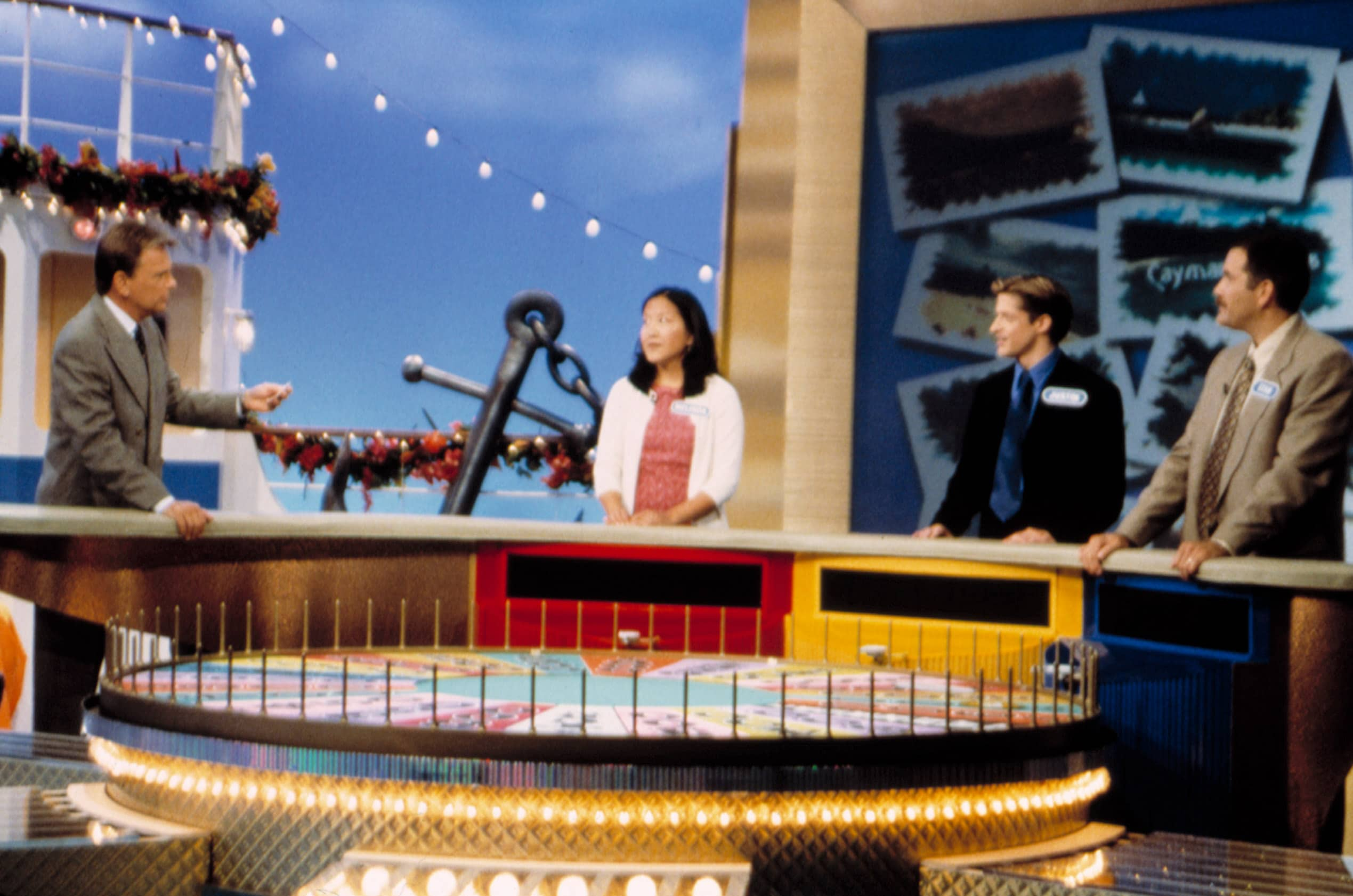 wheel of fortune contestants and host pat sajak