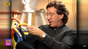 Tim Allen with a toy of Sheriff Woody