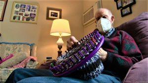 Tom Cornish knitting a hat