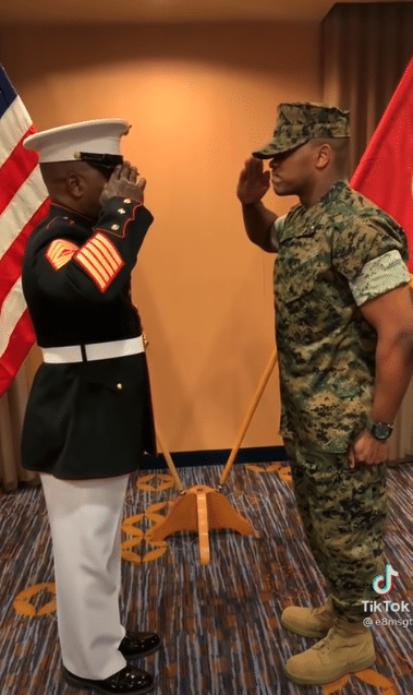 Marine father and son salute each other