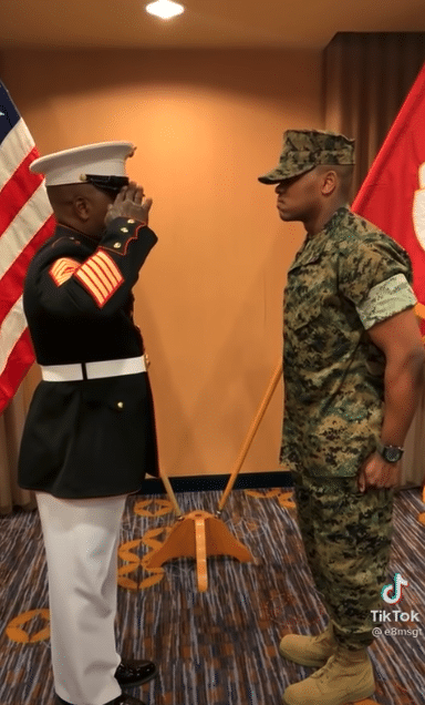 Father gives his son military salute