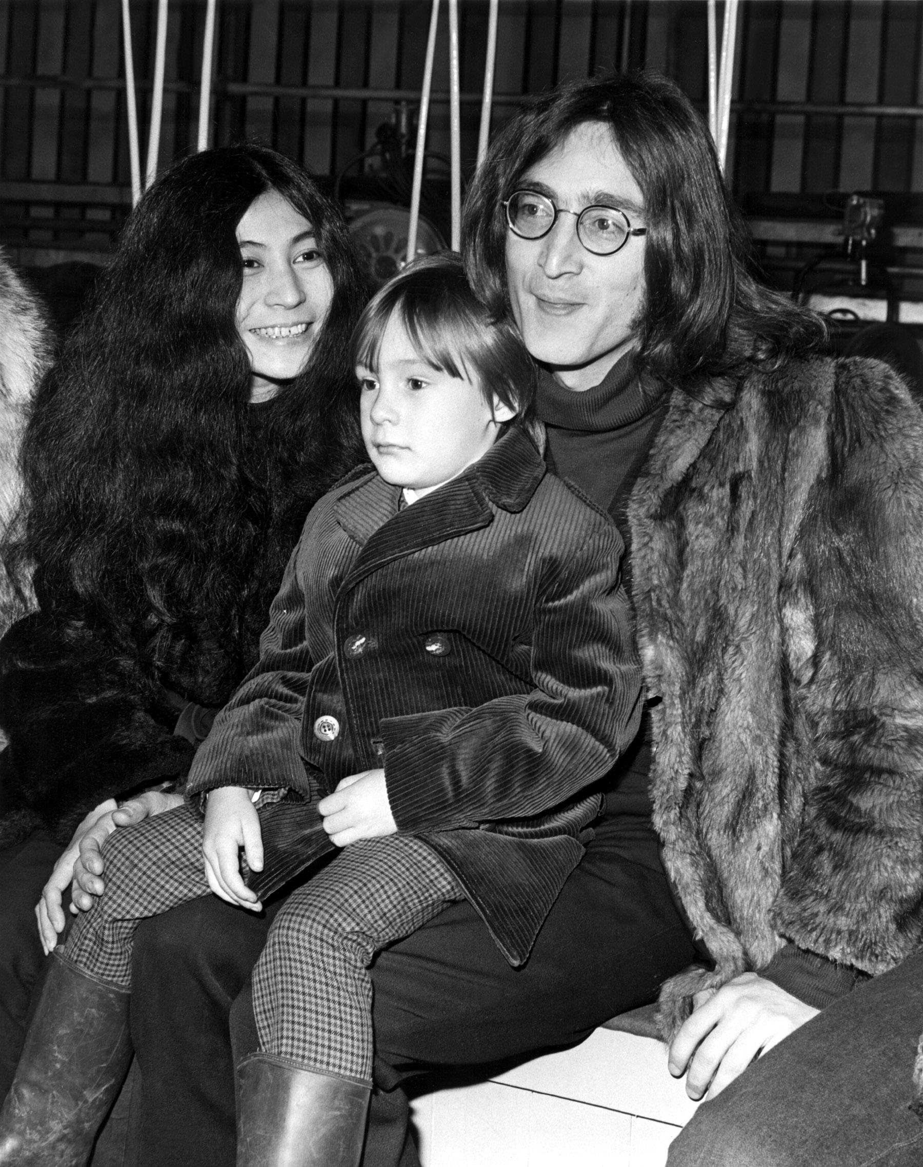 Yoko Ono, Julian Lennon, John Lennon watching the rehearsal for ROLLING STONES' ROCK 'N' ROLL CIRCUS in England, 12/11/68