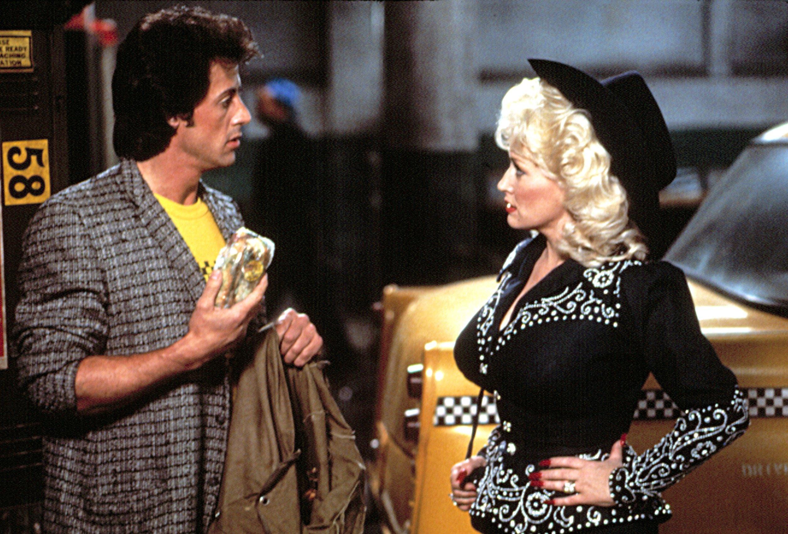 RHINESTONE, Sylvester Stallone, Dolly Parton, 1984