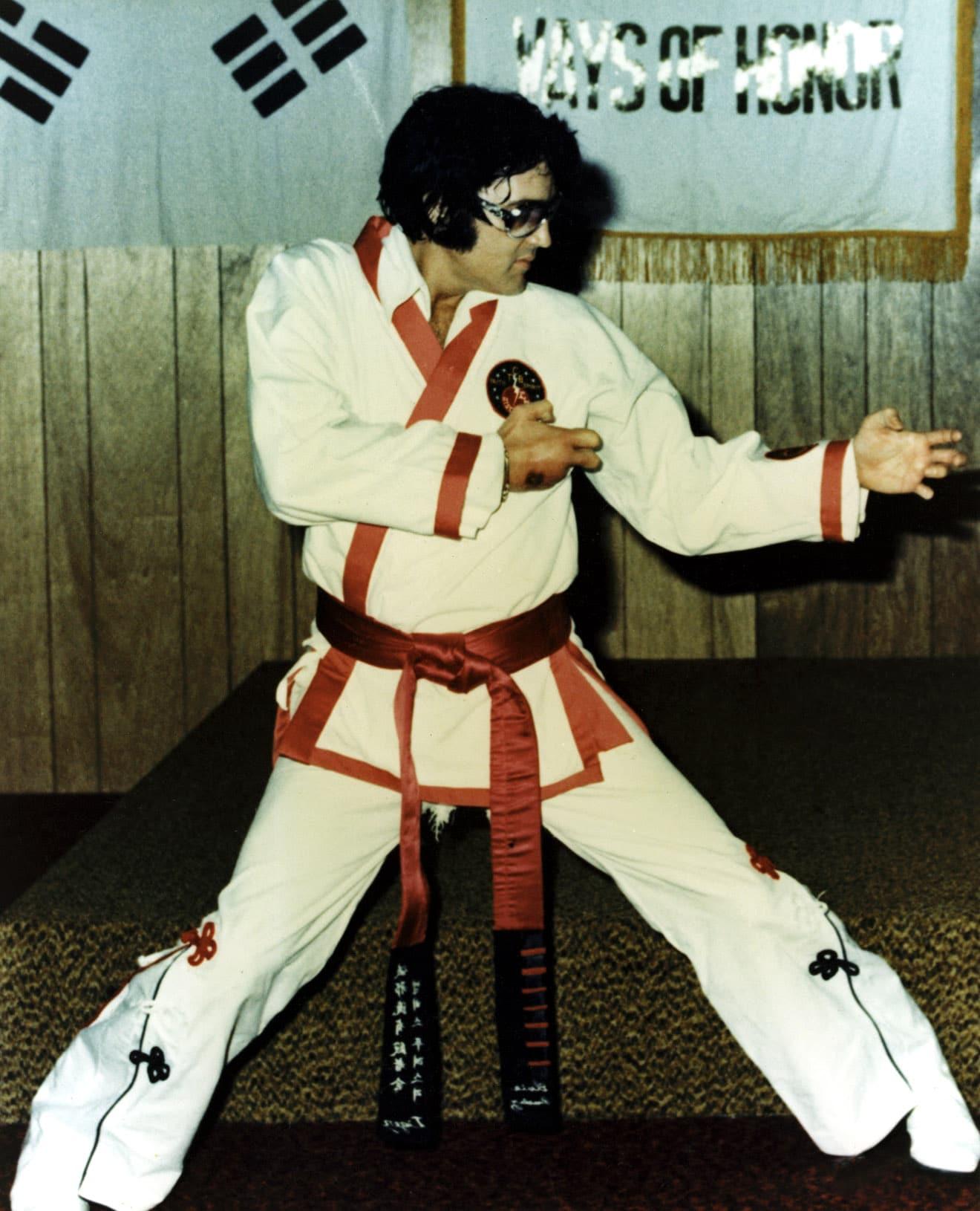 ELVIS PRESLEY practices his karate, c. early 1970s