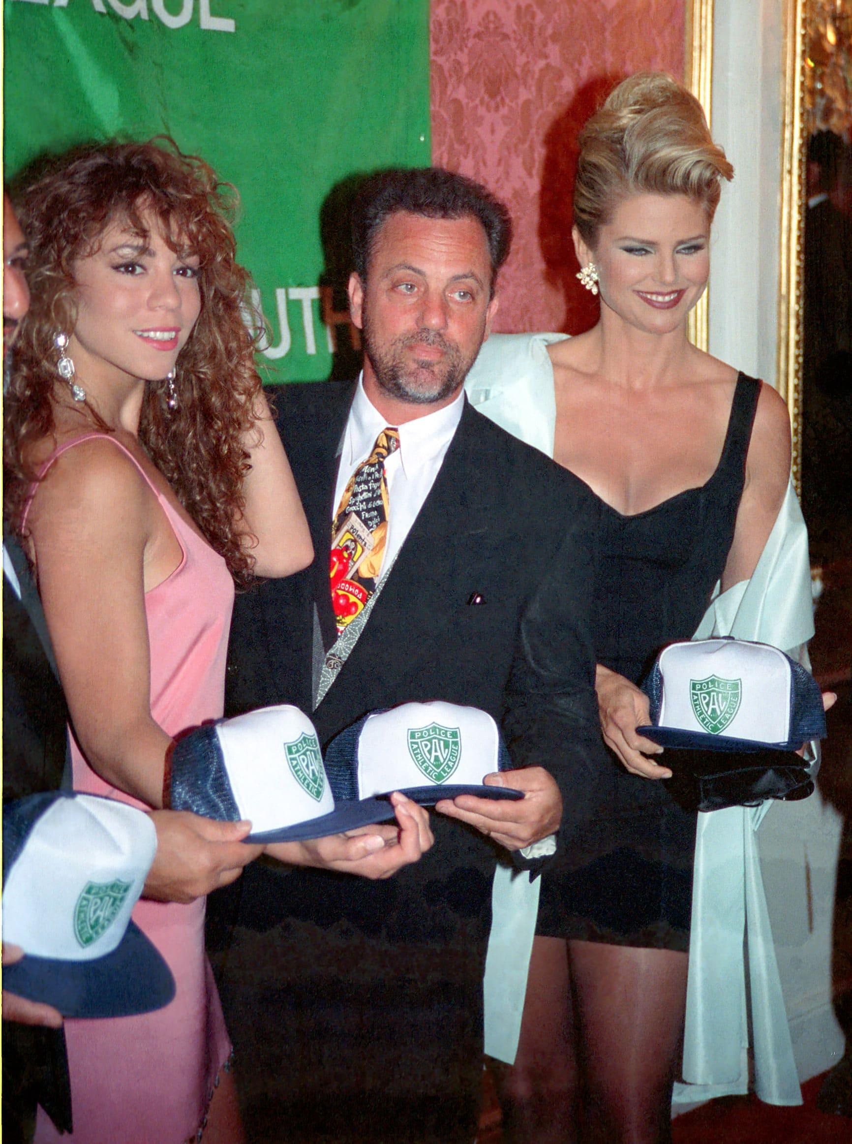 NEW YORK, CIRCA 1995: MARIAH CAREY, BILLY JOEL, CHRISTIE BRINKLEY