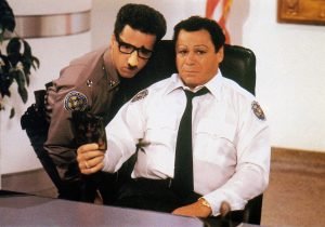 POLICE ACADEMY 3: BACK IN TRAINING, from left: Lance Kinsey, Art Metrano