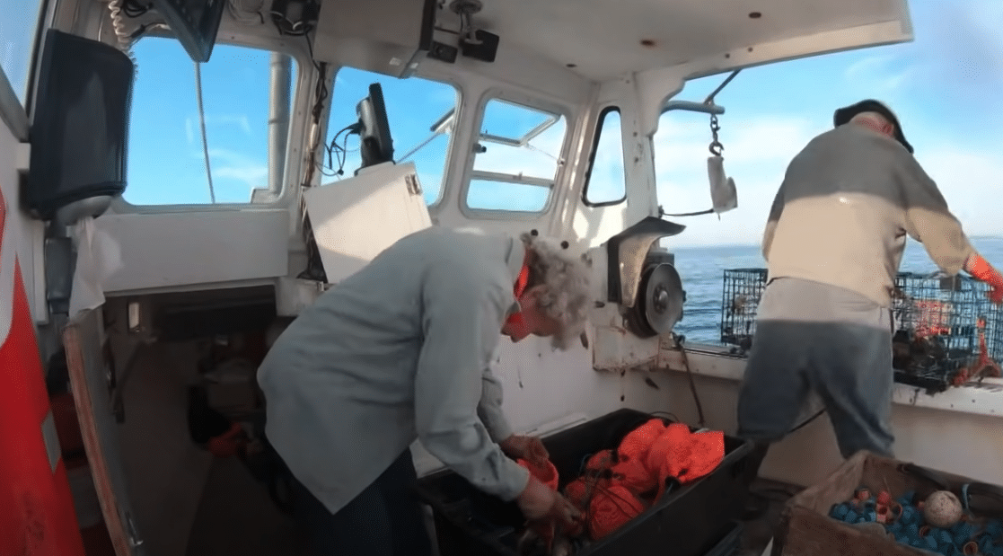 Virginia Oliver lobster fishing with her son